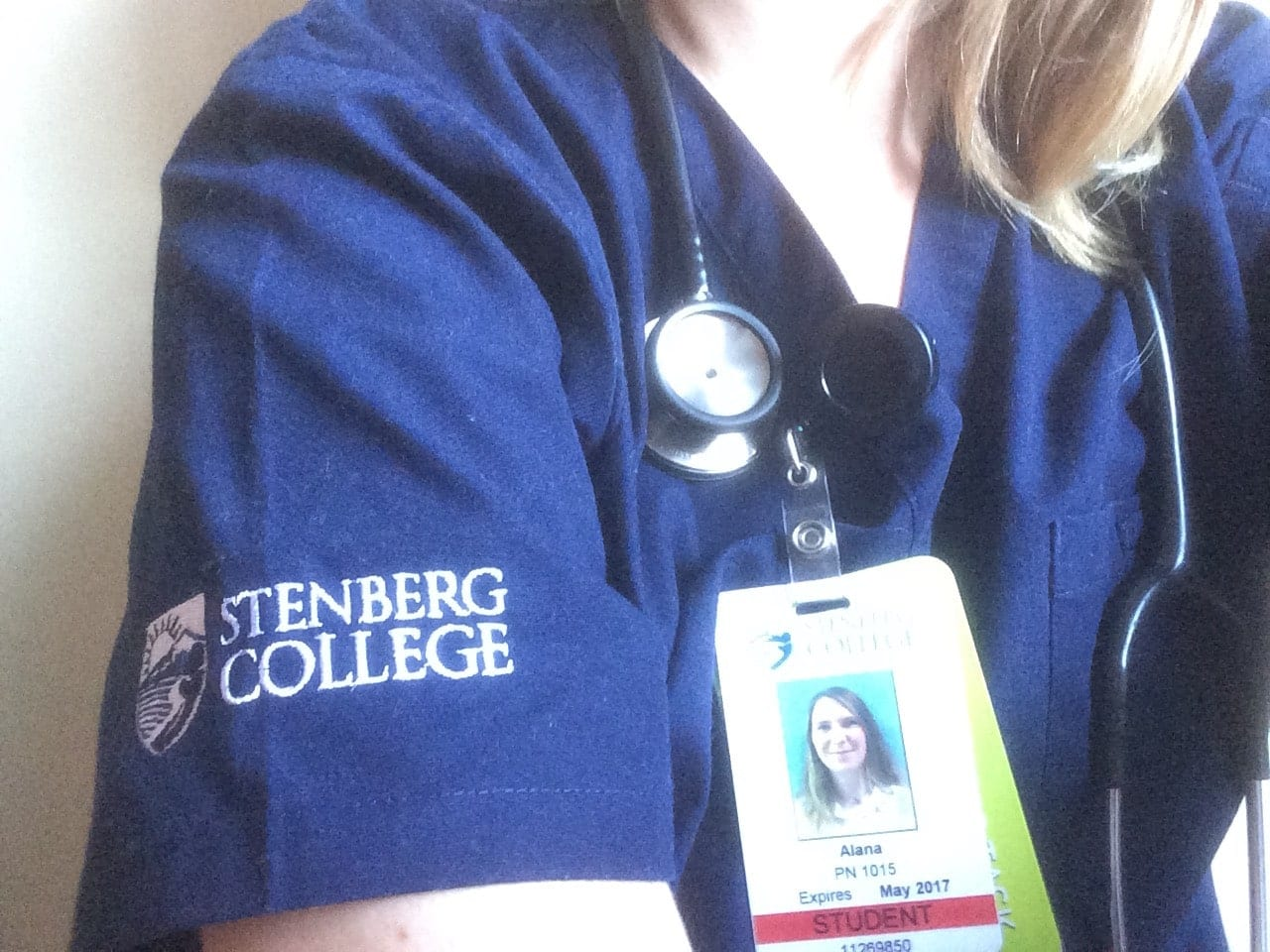 Alana wearing Stenberg's scrubs and student ID during her Preceptorship as a Practical Nurse.