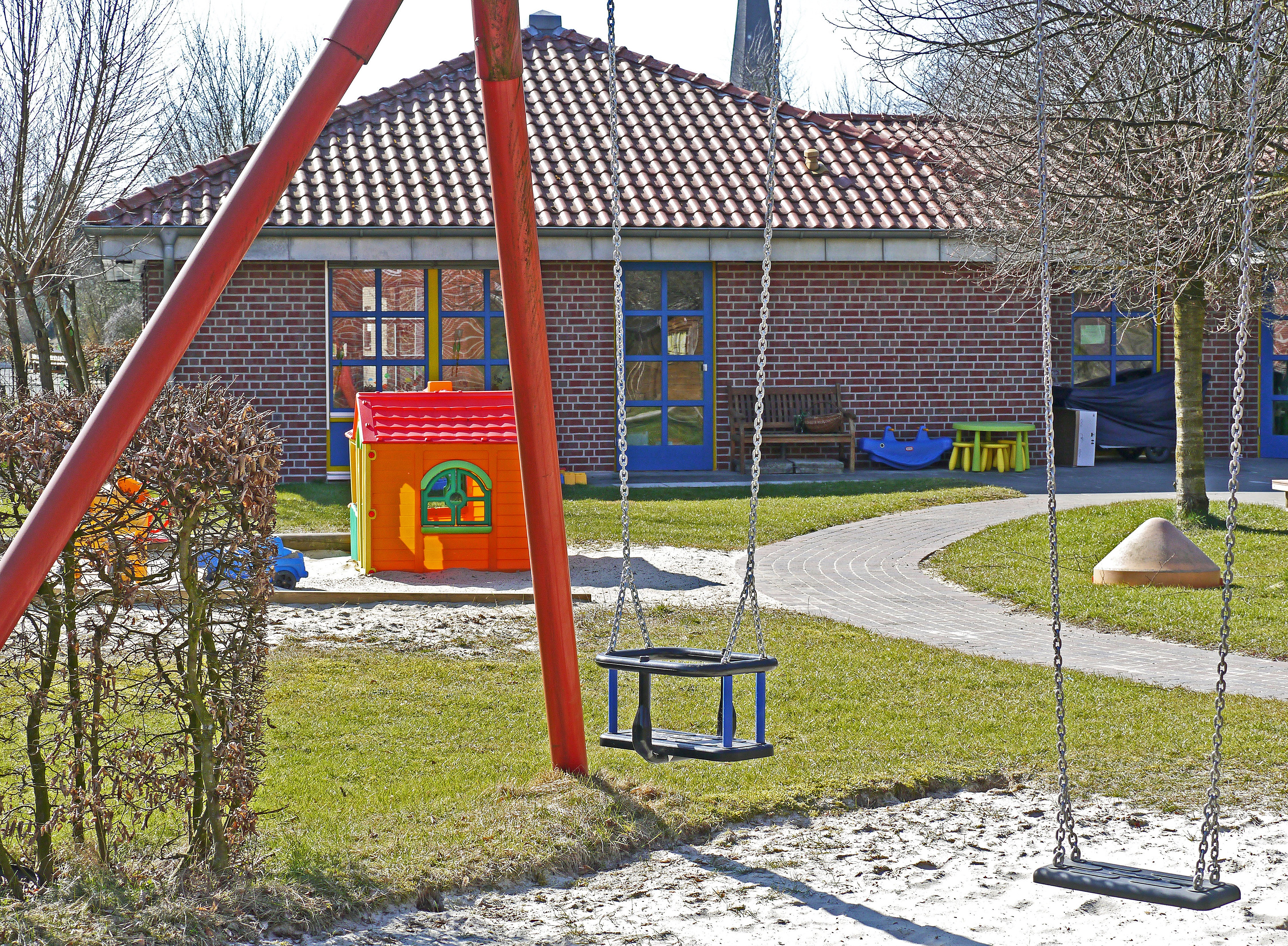 Childcare with lawn and swings, the main workplace for Early Childhood Educators.