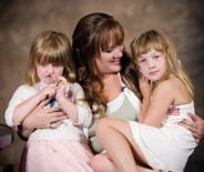Elisha and her two daughters. Not even the $20,000 prize made her change her mind: her friend deserved it better.