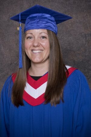 Debra Andrew can't hide her happiness while wearing a graduation gown after completing her Psych Nursing course at Stenberg.