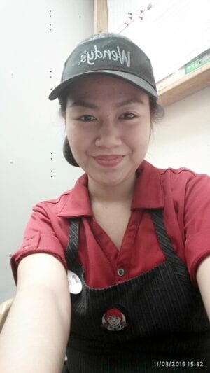 Faith at her job at Wendy's. When in Canada she worked for two years to pay for her family's tuition in the Phillippines.