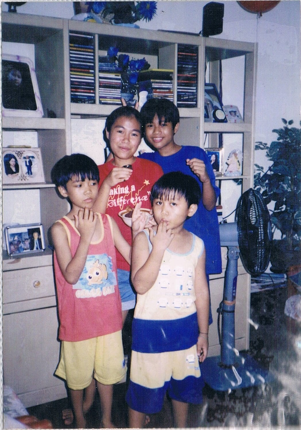 Faith having fun with her younger siblings in their home in the Philippines.