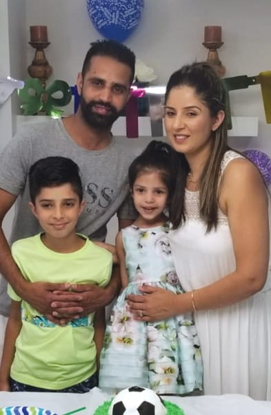 Harpreet, husband and children. They've all supported her through her dream of becoming a NUC.