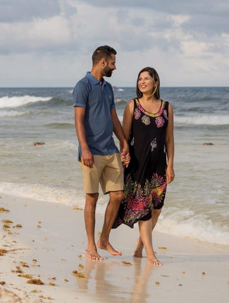 Harpreet walking with husband on a canadian beach. Coming to Canada was a good decision after all.