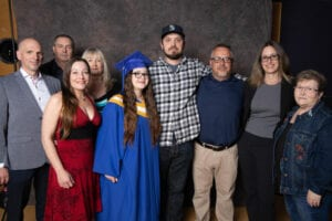 Sammi and her boyfriend and family at her Graduation. They all came to share her happiness.
