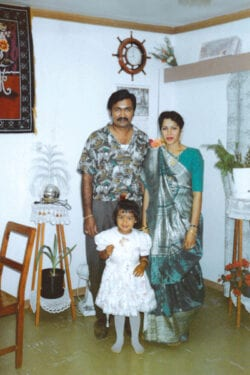 V and her parents in their house in Fiji. V felt safe in her home country, but it all changed when they moved to Canada.